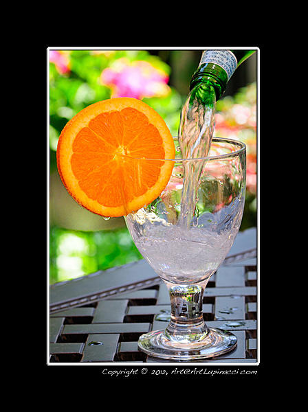 How would you compare canon and nikon dslr-orange-drink.jpg