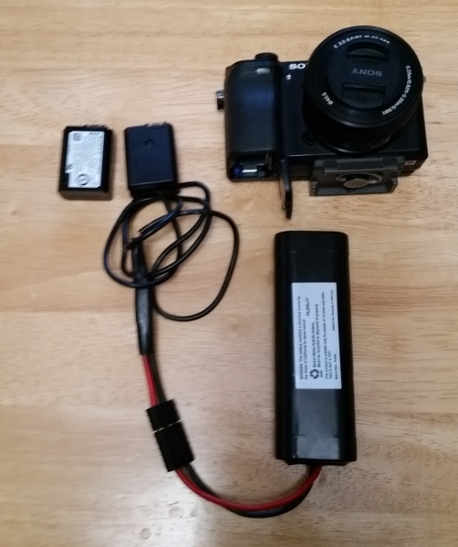 Would a external battery pack and a dummy battery work?-a6300-rc-pack.jpg