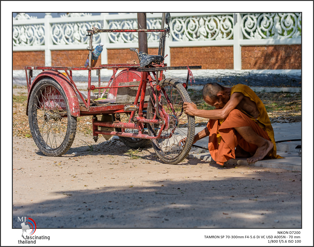 Monk fixing his cart-monk-1.jpg