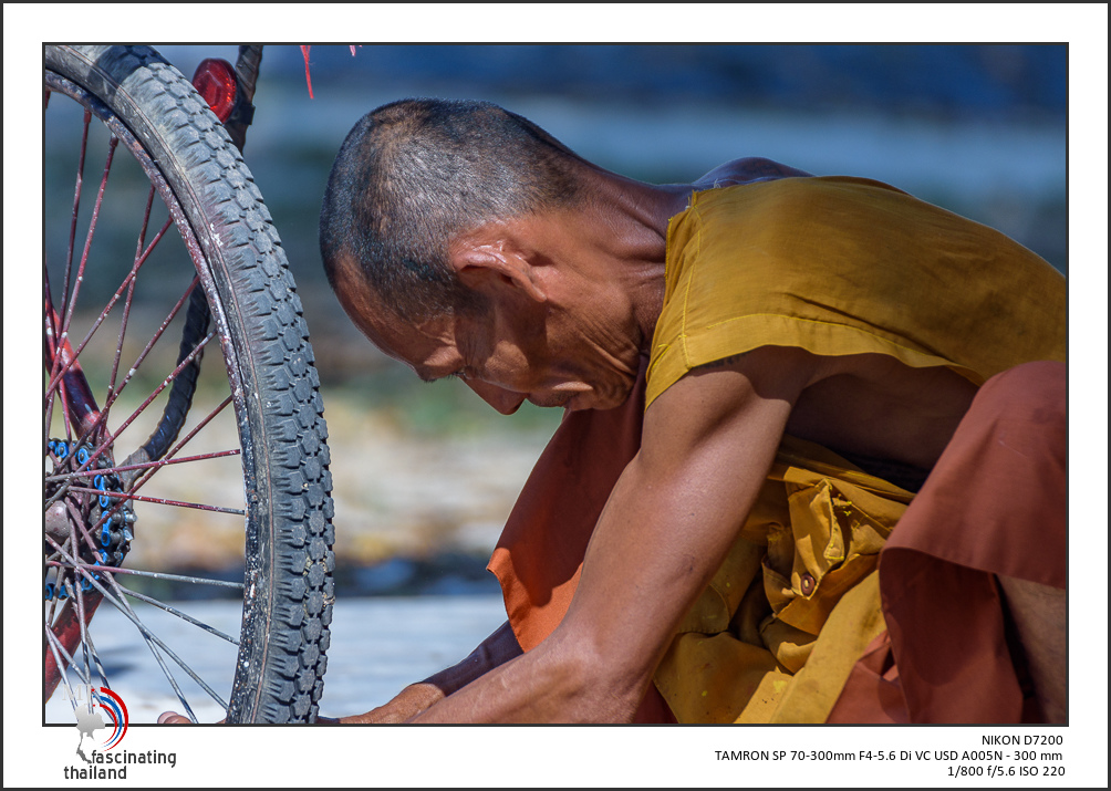 Monk fixing his cart-monk-2.jpg