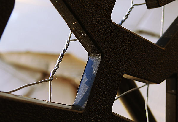 Weekly Challenge July 11-18: SHAPES-barbed-wire-behind-privacy-screen.jpg
