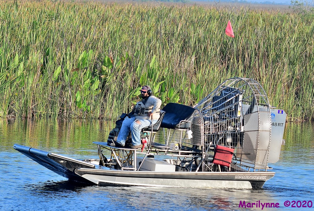Airboat Worker People by Marilynne in Transportation