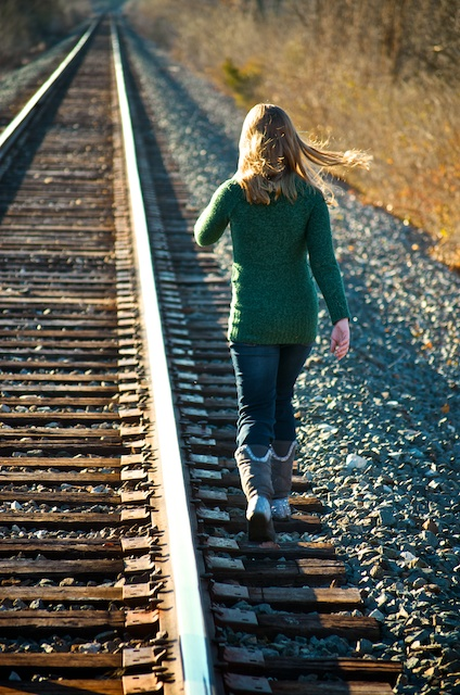 Daughter walking down train tracks by Philth in Member Albums