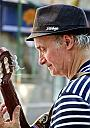 street musician by smile and wave in Street Photography
