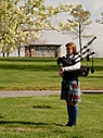 Farewell Bagpiper by Mis Adam in 2014