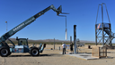 """Loading our 8"""" P-7400 rocket motor on test stand by Rocket Rick in Rocket tests and launches"""